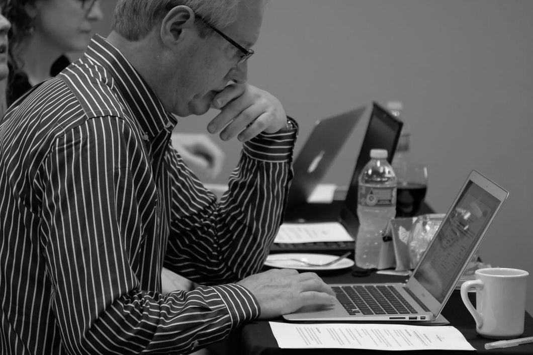 PR professional conducts an online search as part of a client's reputation management program